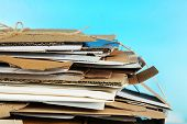 Big stack of papers on blue background, close-up