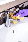 Cleaning bathroom sink close-up