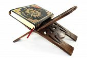 image of quran  - Quran with Quran wooden stand in front of white background - JPG