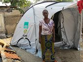 Homeless Marina Issu Next To Her Disaster Relief Tent