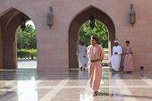 An Arab Man Walking At The Sultan Qaboos