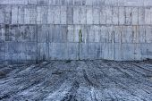 stock photo of stonewalled  - Grey concrete wall with the hardened traces of the shuttering moulds - JPG