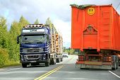Volvo FH16 Logging Truck And A Trailer Truck On The Road