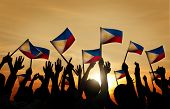 pic of waving hands  - Group of People Waving Filipino Flags in Back Lit - JPG