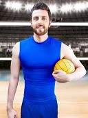 Volleyball player on blue uniform on volleyball court.