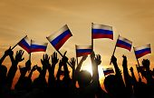 Group of People Waving Russian Flags in Back Lit