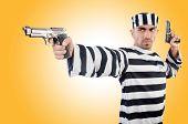 Prisoner with gun isolated on white
