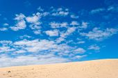 Desert Dune And Cloudy Sky