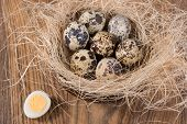 Quail Eggs Lying In A Wooden Table