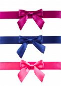 Colored ribbons with bows on white background.