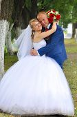 Happy bride and groom in the park