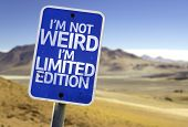 I'm Not Weird Im Limited Edition sign with a desert background