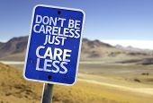 Don't Be Careless Just Care Less sign with a desert background
