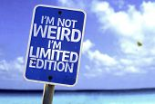 I'm Not Weird Im Limited Edition sign with a beach on background