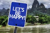 Let's Be Happy sign with a forest background