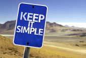 Keep It Simple sign with a desert background