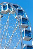 Ferris Wheel Over Clear Blue Sky