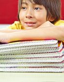 Japanese student with notebooks with spiral binding in school