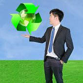 Businessman Holding Environmental Concept Symbol Of Green Reduce - Reuse - Recycle