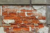 Old Brick Wall With Plaster Shelled