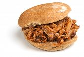 Pulled pork with barbeque sauce in a soft bread roll.