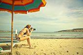 Girl using a binoculars at the seaside