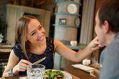 Happy couple eating in restaurant