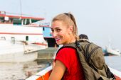 picture of bagpack  - Woman at sightseeing on boat trip in harbour Sunda Kelapa - JPG