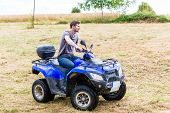 Man driving off-road with quad bike or ATV