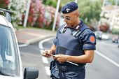 Italian special military police force carabinier checking driving documents