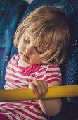 Girl asleep in a bus