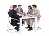 Business People Having Conference Meeting Over White Background