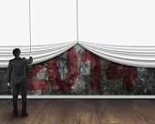 Businessman Pulling Down White Blank Curtain To Cover Old 2014