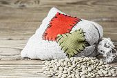 image of thrift store  - Concept of the thrift storing - Canadian lentils in the burlap sack with the patch on a wooden background