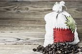 pic of thrift store  - Concept of the thrift storing - Coffee beans in the burlap sack with the patch on a wooden background