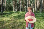 Portrait Of Teenage Boy With Red Wildberries
