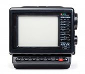 Vintage small portable color TV set with radio on white background