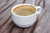 stock photo of cozy hearth  - Cup of hot coffee on a wooden table in cafe - JPG