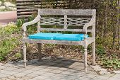 Park Bench With Blue Seat Cushions