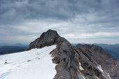 stock photo of thunderhead  - Dachstein glacier in Austria with dramatic sky - JPG