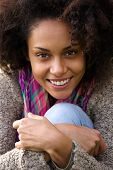 Cute young african american woman smiling outdoors