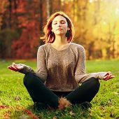 Beautiful Young Girl Meditating