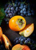 Persimmon And Grapes Still Life.autumn Season Food Photo