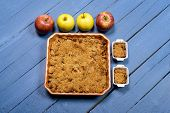Apple Crumble On A Blue Wooden Table