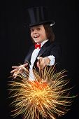 Young Magician Boy Using His Magic Wand
