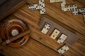Top View Over Table With Cigars And Domino