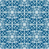 Seamless winter blue floral vector wallpaper pattern.