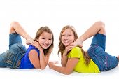 twin kid sisters symmetrical flexible playing happy on white background