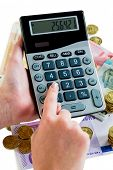 hand with calculator and bills. photo icon for revenue, profit, taxes and costing