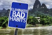 Eliminate Bad Habits sign with a forest background